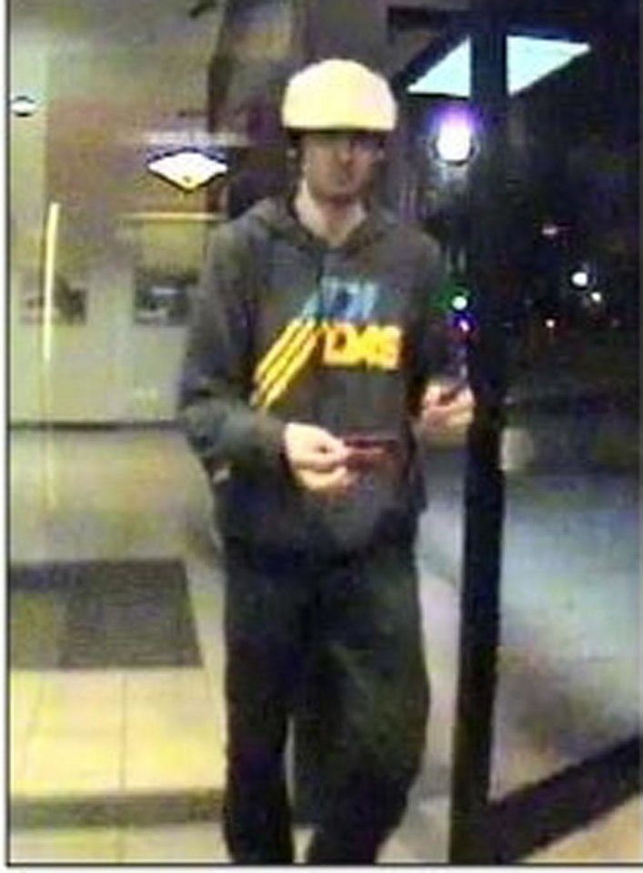 Photo - This image taken from surveillance video provided by the Boston Regional Intelligence Center shows Boston Marathon bombing suspect Dzhokhar Tsarnaev at a Bank of America ATM in Watertown, Mass. at 11:18 p.m. on April 18, 2013. The next day, police intercepted Dzhokhar and his 26-year-old brother Tamerlan in a blazing gunbattle that the elder brother dead. Dzhokhar, 19, is charged with carrying out the Boston Marathon bombing April 15 that killed three people and wounded more than 260, and he could get the death penalty. (AP Photo/Boston Regional Intelligence Center)