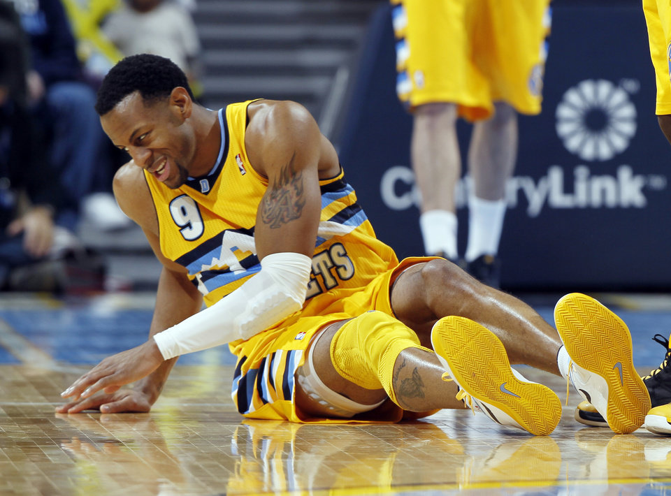 Denver Nuggets guard Andre Iguodala sits on the court after injuring his leg against the Oklahoma City Thunder in the third quarter of their NBA basketball game in Denver, Sunday, Jan. 20, 2013. The Nuggets won 121-118 in overtime. (AP Photo/David Zalubowski)