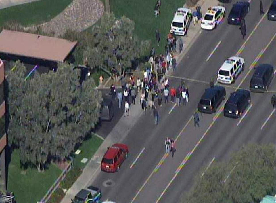 This frame grab provided by abc15.com shows the scene at a Phoenix office complex where police say someone shot at least three people on Wednesday, Jan. 30, 2013. Officer James Holmes said the victims were taken to hospitals and did not know if their injuries were life threatening. (AP Photo/abc15.com) MANDATORY CREDIT  ORG XMIT: NY115