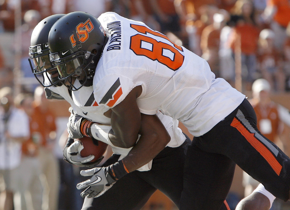 Photo - Oklahoma State's Jeremy Smith (31) and Justin Blackmon (81) celebrate a touchdown during second half of a college football game between the Oklahoma State University Cowboys (OSU) and the University of Texas Longhorns (UT) at Darrell K Royal-Texas Memorial Stadium in Austin, Texas, Saturday, Oct. 15, 2011. Photo by Sarah Phipps, The Oklahoman
