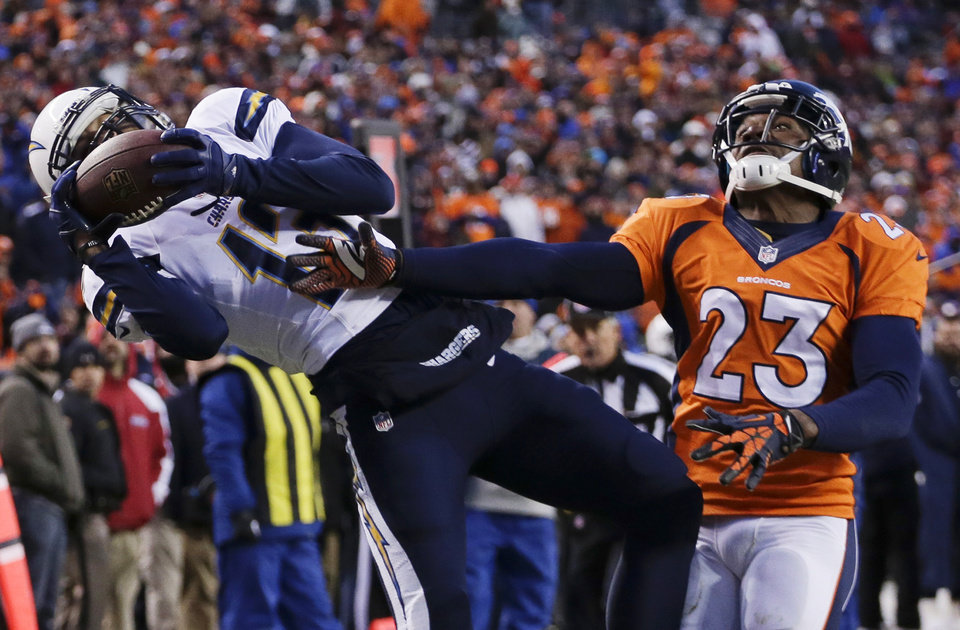 Photo - San Diego Chargers wide receiver Keenan Allen (13) catches a pass for a touchdown against Denver Broncos cornerback Quentin Jammer (23) in the fourth quarter of an NFL AFC division playoff football game, Sunday, Jan. 12, 2014, in Denver. (AP Photo/Charlie Riedel)