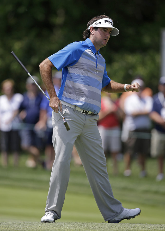 Photo - Bubba Watson reacts to making a birdie putt on the first hole during the final round of the Memorial golf tournament, Sunday, June 1, 2014, in Dublin, Ohio. (AP Photo/Darron Cummings)