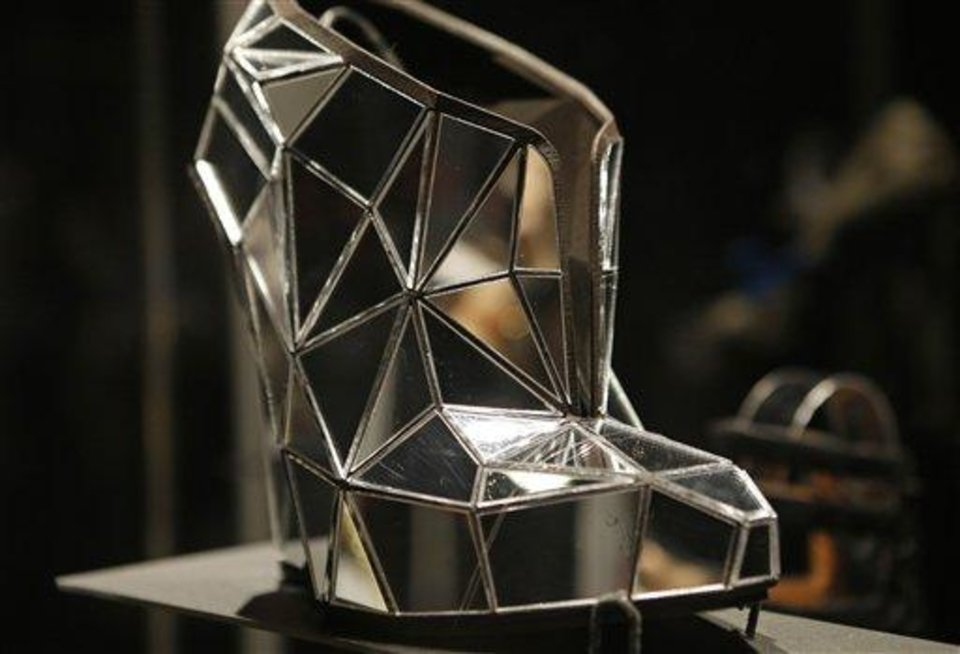 Photo - This Feb. 11, 2013 photo shows a shoe, made of mirror fragments titled