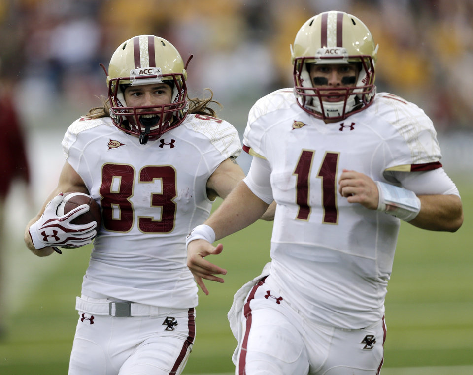 Photo -   Boston College wide receiver Alex Amidon (83) runs behind quarterback Chase Rettig (11) to score a touchdown against Army during the second half of an NCAA college football game Saturday, Oct. 6, 2012, in West Point, N.Y. Army won, 34-31. (AP Photo/Mike Groll)