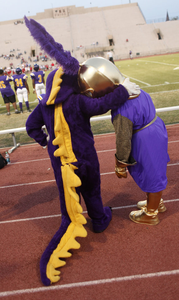 NWC mascots bond at the Northwest Classen vs. Western Heights high school football game at Taft Stadium Thursday, September 20, 2012. Photo by Doug Hoke, The Oklahoman