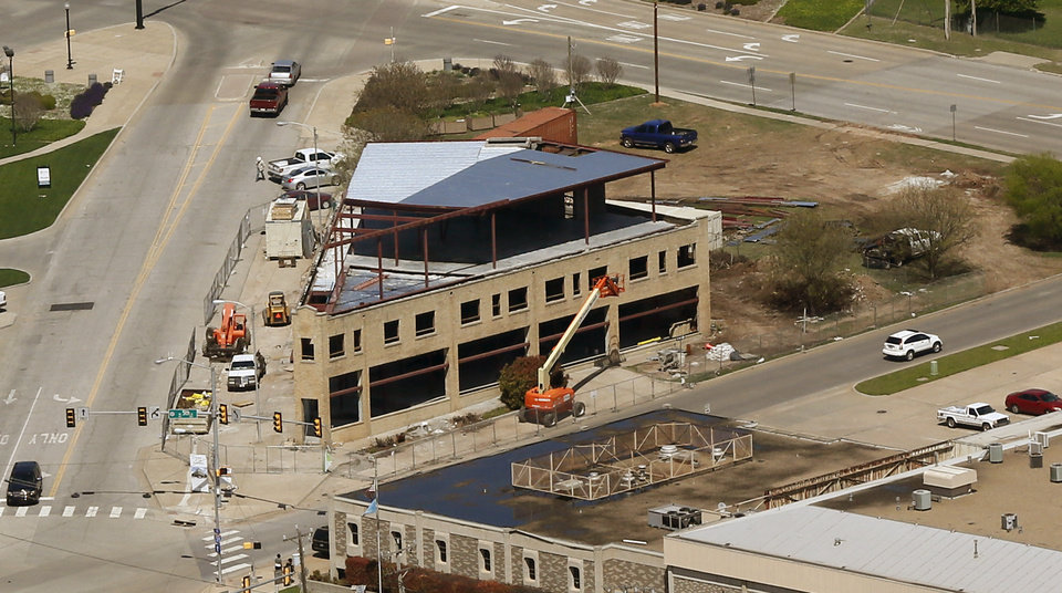 Photo -  Addition of a third floor to the flatiron building at NW 5 and Harrison can be seen Wednesday in this photo from overhead.  Photo by Nate Billings, The Oklahoman   NATE BILLINGS -  NATE BILLINGS