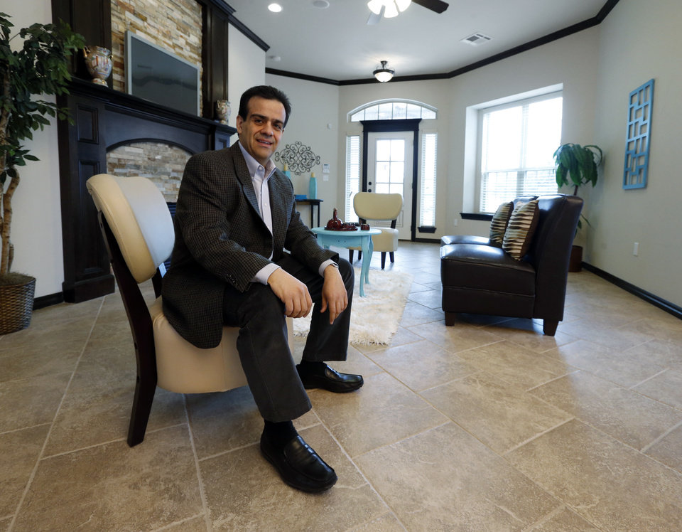 Photo - Ali Farzaneh, owner of First Oklahoma Construction, is shown inside 220 Boulevard Du Lac in the Summit Lake Villas addition in Norman.  PhotoS by Steve Sisney, The Oklahoman  STEVE SISNEY -