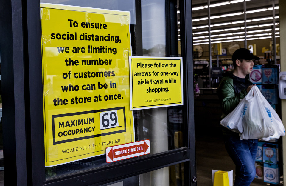Photo - Signs notify customers of new shopping procedures for the Homeland located at 1108 NW 18th St. in Oklahoma City, Okla. on Monday, April 13, 2020. The store has taken extra steps to help protect its employees and customers during the coronavirus pandemic.   [Chris Landsberger/The Oklahoman]