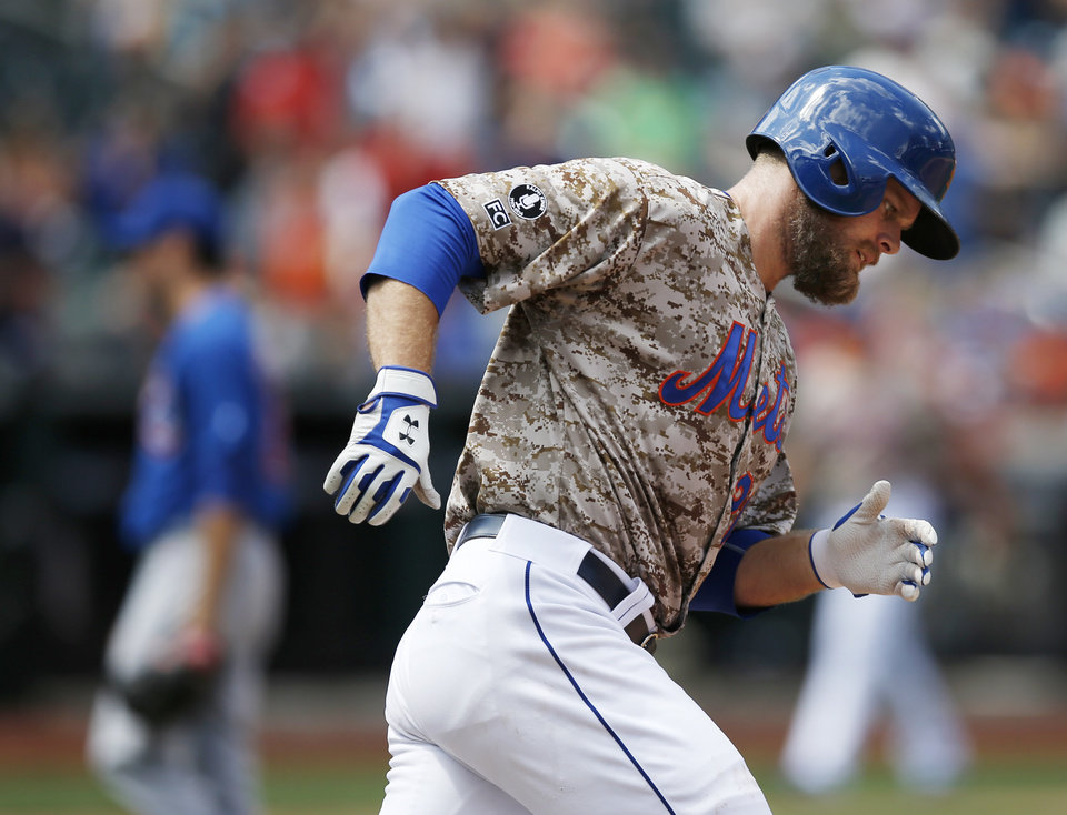 Photo - New York Mets' Lucas Duda runs the bases after hitting a fourth-inning solo home run off Chicago Cubs starting pitcher Kyle Hendricks in a baseball game at Citi Field in New York, Monday, Aug. 18, 2014. (AP Photo/Kathy Willens)