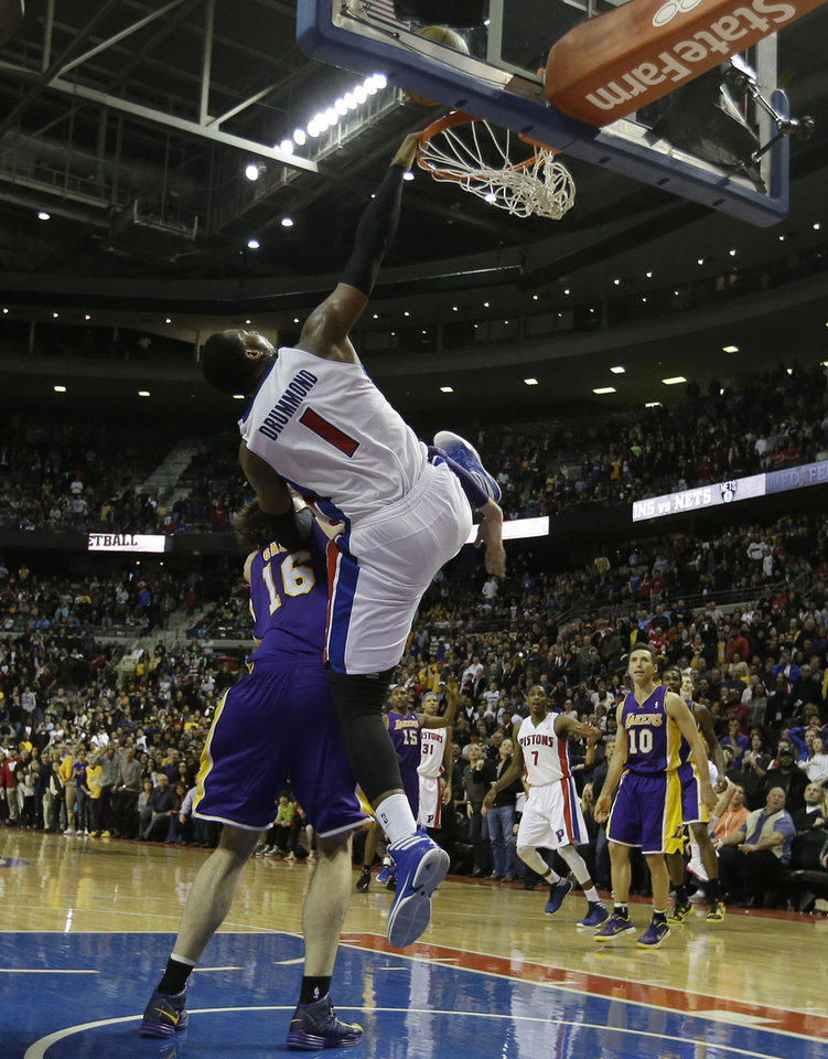 Detroit Pistons center Andre Drummond (1), defended by Los Angeles Lakers forward Pau Gasol (16), of Spain, misses his last-second alley-oop-attempt at the end of the fourth quarter of an NBA basketball game at the Palace of Auburn Hills, Mich., Sunday, Feb. 3, 2013. (AP Photo/Carlos Osorio)