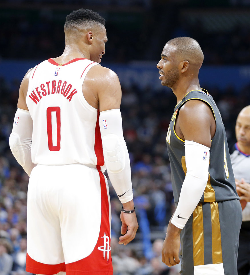 Photo - Houston's Russell Westbrook (0) talks with Oklahoma City's Chris Paul (3) during an NBA basketball game between the Oklahoma City Thunder and Houston Rockets at Chesapeake Energy Arena in Oklahoma City, Thursday, Jan. 9, 2020. [Bryan Terry/The Oklahoman]