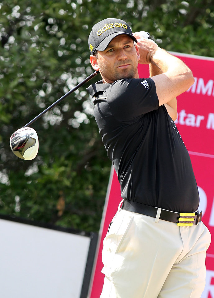 Sergio Garcia of Spain plays his shot on the 1st hole during the Second  round of the Commercial Bank Qatar Masters held at the Doha Golf Club in Qatar, Thursday, Jan. 24, 2013. (AP Photo/Osama Faisal)