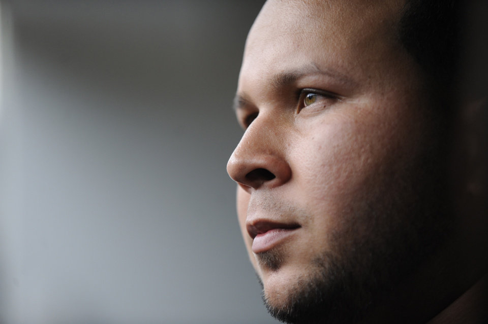 Photo - File-This Sept. 11, 2013, file photo shows suspended Detroit Tigers shortstop Jhonny Peralta looking on after working out with the team before an MLB baseball game against the Chicago White Sox in Chicago. Matt Holliday has been an outspoken critic of players who have used performance-enhancing drugs. When it comes to Peralta, his new St. Louis Cardinals teammate, he is willing to forgive and forget. (AP Photo/Paul Beaty, File)