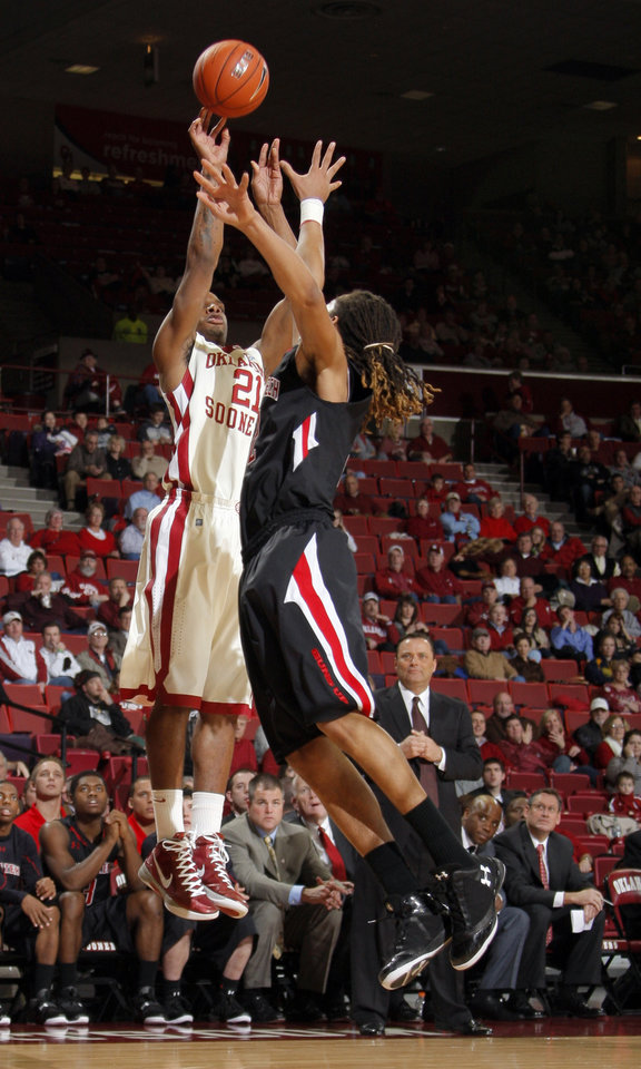 Photo - Oklahoma's Cameron Clark (21) shoots as Texas Tech's Terran Petteway (2) defends during the men's college basketball game between the University of Oklahoma  and Texas Tech University of at the Lloyd Nobel Center in Norman, Okla., Tuesday, Jan. 17, 2012. Photo by Sarah Phipps, The Oklahoman