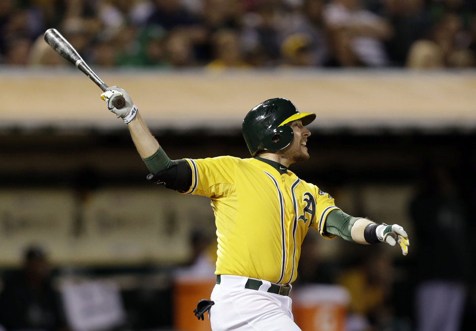Oakland Athletics' Jed Lowrie hits a three-run home run against the Minnesota Twins during the sixth inning of a baseball game on Thursday, Sept. 19, 2013, in Oakland, Calif. (AP Photo/Marcio Jose Sanchez)