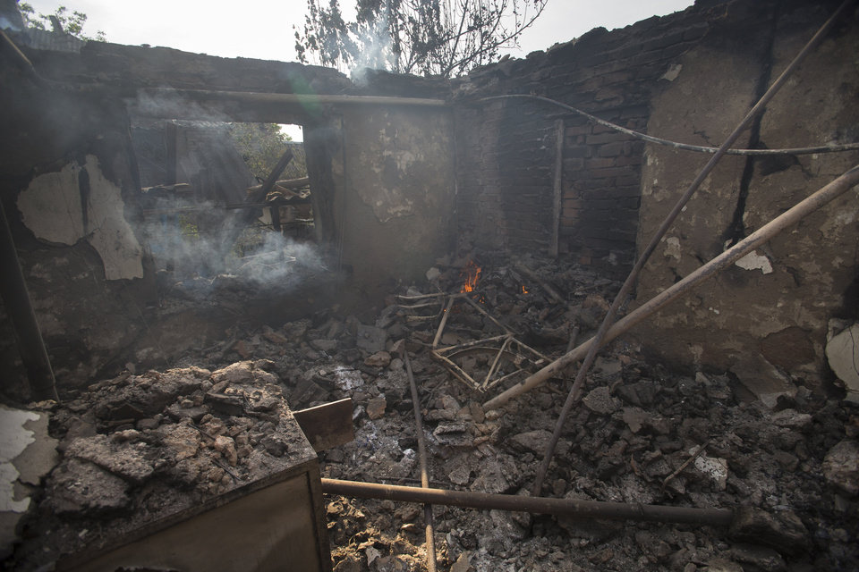 Photo - A destroyed house, following a motor attack, is seen in Semyonovka village, outside Slovyansk, Ukraine, Friday, May 23, 2014. The village on the outskirts of Slovyansk, a city which has been the epicenter of clashes for weeks, has seen continuous shelling by the Ukrainian government forces, who have retaliated to the rebel fire. On Friday, a private house was destroyed by mortar fire that came from the Ukrainian side. There were no casualties, as the family living there had left the previous day, according to local residents. (AP Photo/Alexander Zemlianichenko)