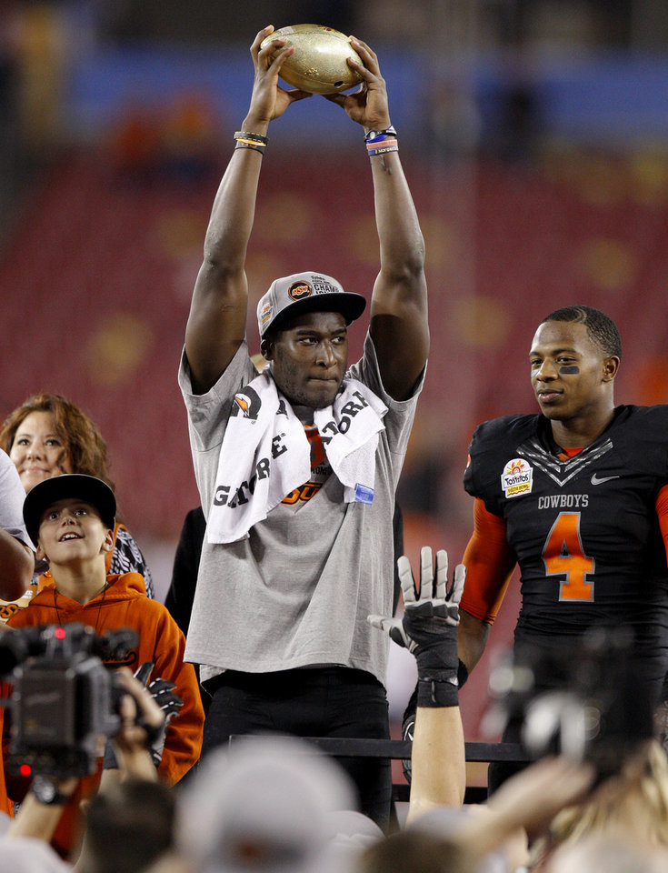 Photo - Oklahoma State's Justin Blackmon holds up the Fiesta Bowl trophy beside Justin Gilbert after winning the Fiesta Bowl between the Oklahoma State University Cowboys (OSU) and the Stanford Cardinal at the University of Phoenix Stadium in Glendale, Ariz., Tuesday, Jan. 3, 2012. Photo by Bryan Terry, The Oklahoman
