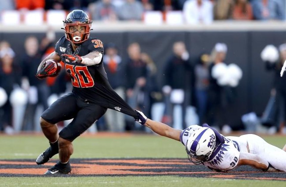 Photo -  Oklahoma State's Chuba Hubbard has rushed for 1,604 yards this season, while no other Division I running back has reached 1,300 yards. [Sarah Phipps/The Oklahoman]