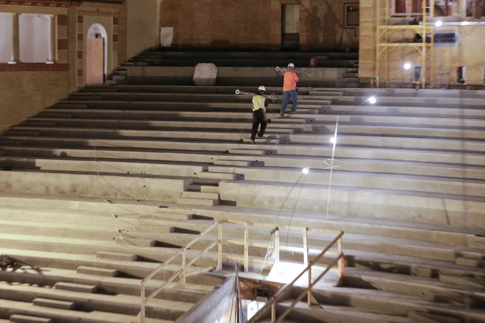 Photo - Workers walk up stairs during the restoration of the Saenger Theater in Downtown New Orleans on Wednesday, May 22, 2013. (AP Photo/Gerald Herbert)