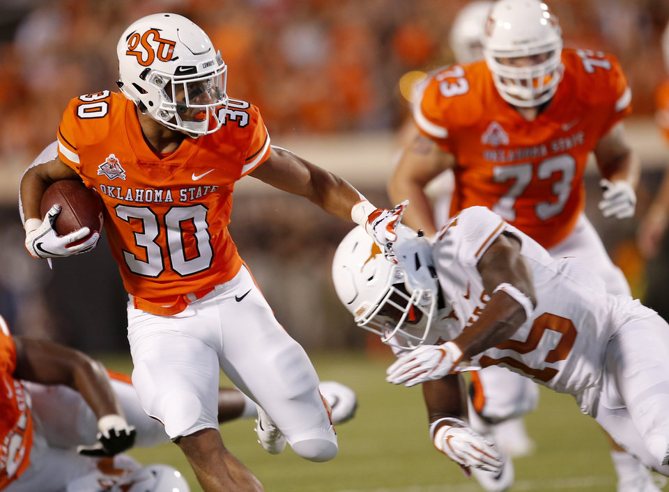 Photo -  Chuba Hubbard (30) will be Oklahoma State's primary running back in the Liberty Bowl after Justice Hill elected to sit out. [PHOTO BY SARAH PHIPPS, THE OKLAHOMAN]