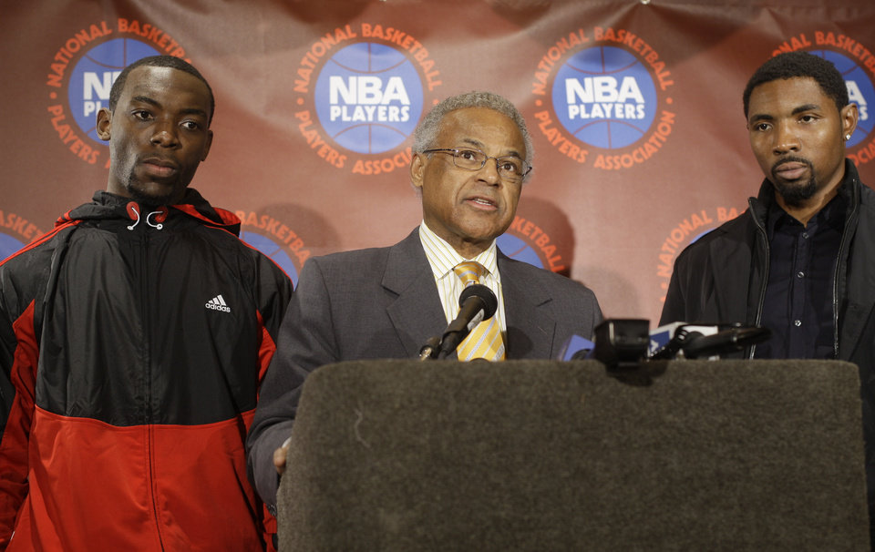 NBA Players Roger Mason, Jr., right, and Charles Jenkins, left, look on as Billy Hunter speak during a news conference Tuesday, Nov. 22, 2011 in New York. After filing two separate antitrust lawsuits against the league in different states, NBA players are consolidating their efforts and have turned to the courts in Minnesota as their chosen venue. (AP Photo/Frank Franklin II)