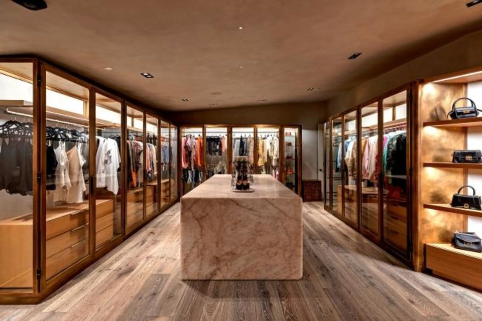 Photo -  John Legend and Chrissy Teigen's home features closet space the size of a clothing store. [TNS PHOTO]