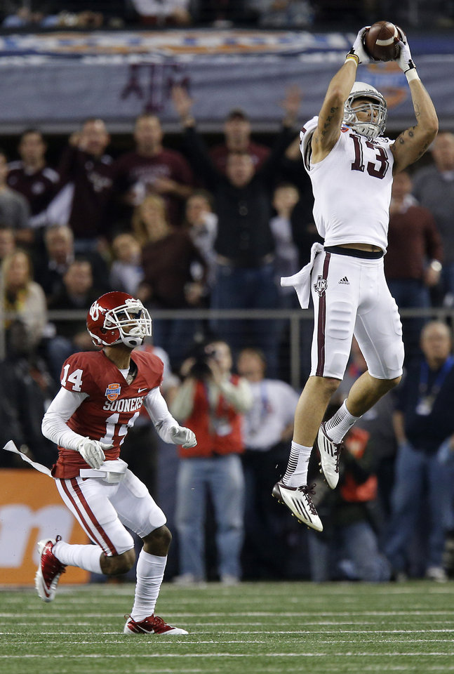 Texas A&M 's Mike Evans (13) makes a catch in front of Oklahoma's Aaron Colvin (14) during the Cotton Bowl college football game between the University of Oklahoma (OU)and Texas A&M University at Cowboys Stadium in Arlington, Texas, Friday, Jan. 4, 2013. Photo by Bryan Terry, The Oklahoman