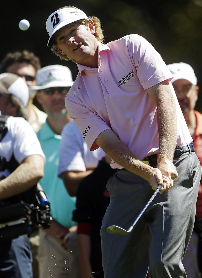 Photo -   Brandt Snedeker chips to the green on the fourth hole during the final round of play in the Tour Championship golf tournament in Atlanta, Sunday, Sept. 23, 2012. (AP Photo/John Bazemore)