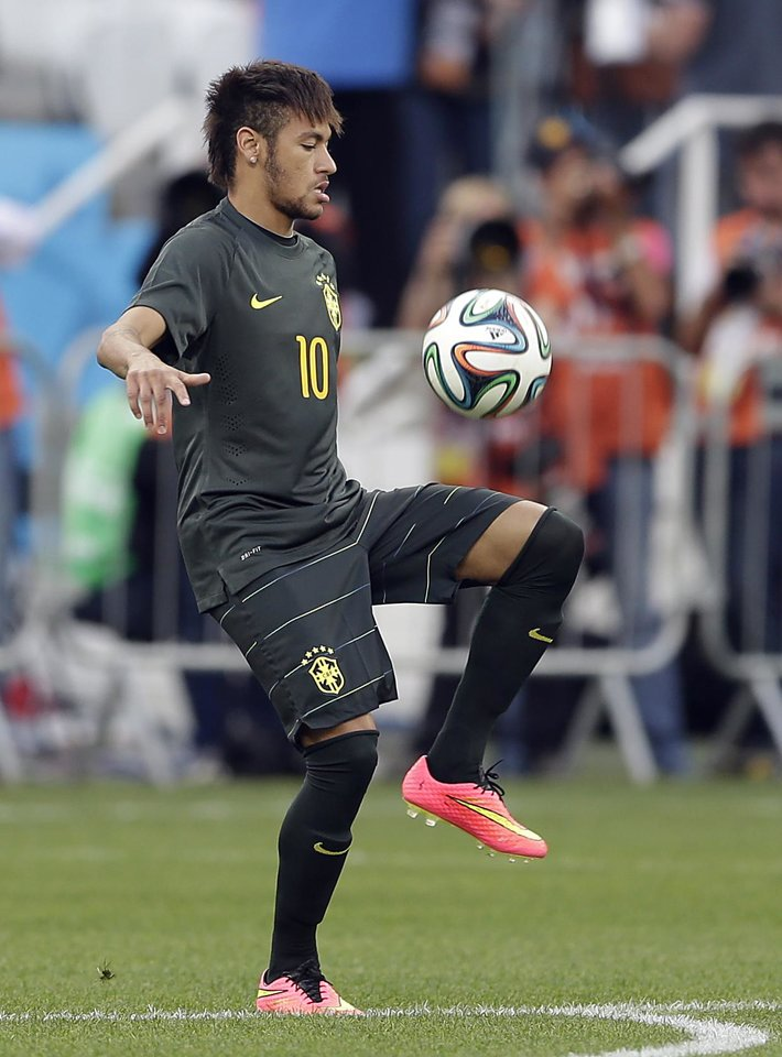 Photo - Brazil's Neymar controls the ball during an official training session the day before the group A World Cup soccer match between Brazil and Croatia in the Itaquerao Stadium, Sao Paulo       , Brazil, Wednesday, June 11, 2014.  (AP Photo/Andre Penner)