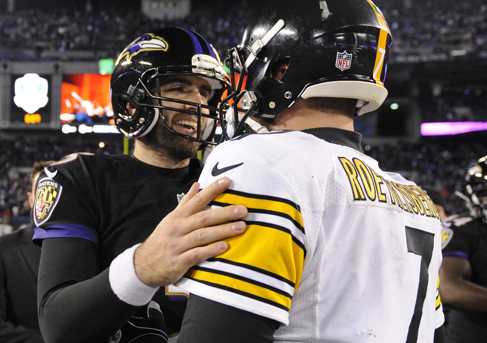 Photo - Baltimore Ravens quarterback Joe Flacco, left, chats with Pittsburgh Steelers quarterback Ben Roethlisberger after an NFL football game, Thursday, Nov. 28, 2013, in Baltimore. Baltimore won 22-20. (AP Photo/Nick Wass)