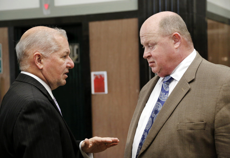 Photo -  Oklahoma County District Attorney David Prater, left, and defense attorney Gary James talk after the bond hearing for Keith Patrick Sweeney. [Photo by Jim Beckel, The Oklahoman]