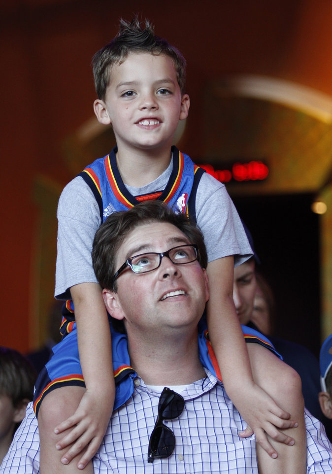 Jay Ridley, of Oklahoma City, holds his son, Coleman, 6, on his shoulders during the red carpet premiere of Thunderstruck at Harkins Bricktown Theatre in Oklahoma City, Sunday, Aug. 19, 2012.  Photo by Garett Fisbeck, For The Oklahoman