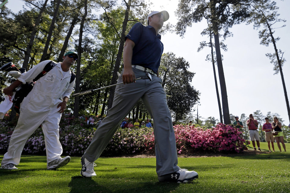 Photo - Jordan Spieth walks with his caddie Michael Greller to the sixth green during the third round of the Masters golf tournament Saturday, April 12, 2014, in Augusta, Ga. (AP Photo/Darron Cummings)