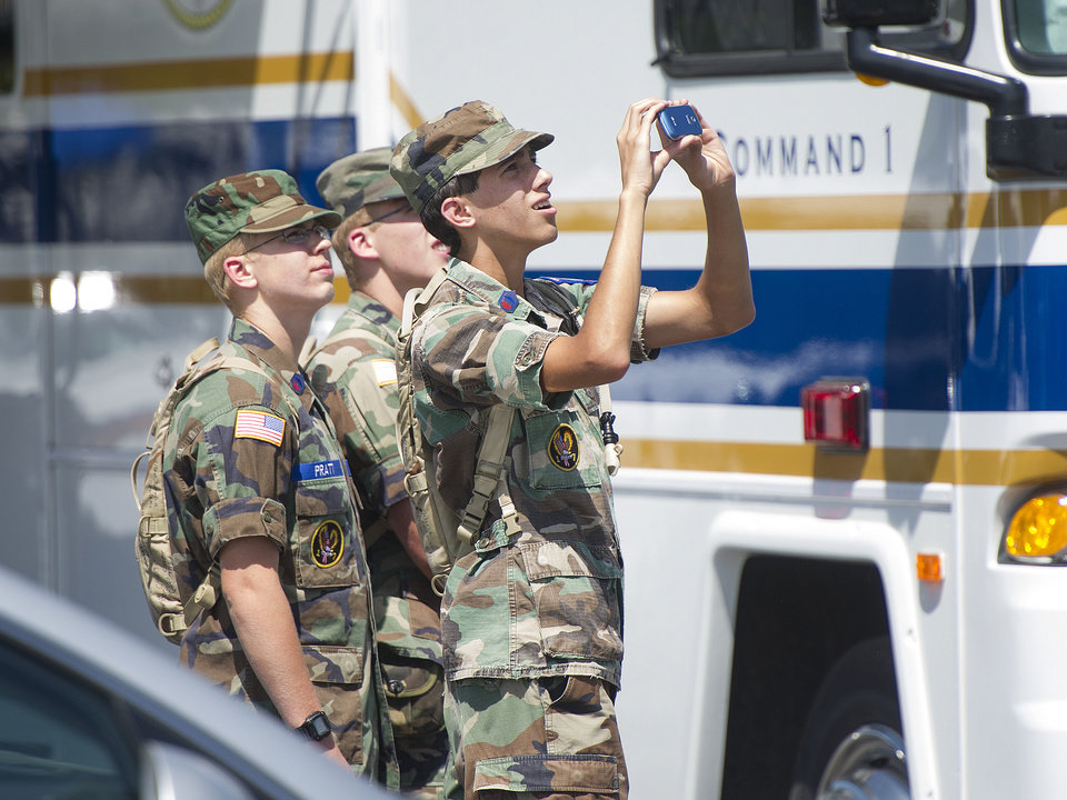 Photo - Young members of the Civil Air Patrol watch a search helicopter take of at the Deerfield Valley Volunteer Fire Department in Deerfield on Thursday, Aug. 28, 2014 in Deerfield, Va. The pilot of an F-15 jet that crashed this week in remote Virginia mountains was killed, military officials said Thursday, bringing to a sad end an exhaustive two-day search involving more than 100 local, state and federal officials as well as volunteers.  (AP Photo/The Staunton News Leader, Griffin Moores)