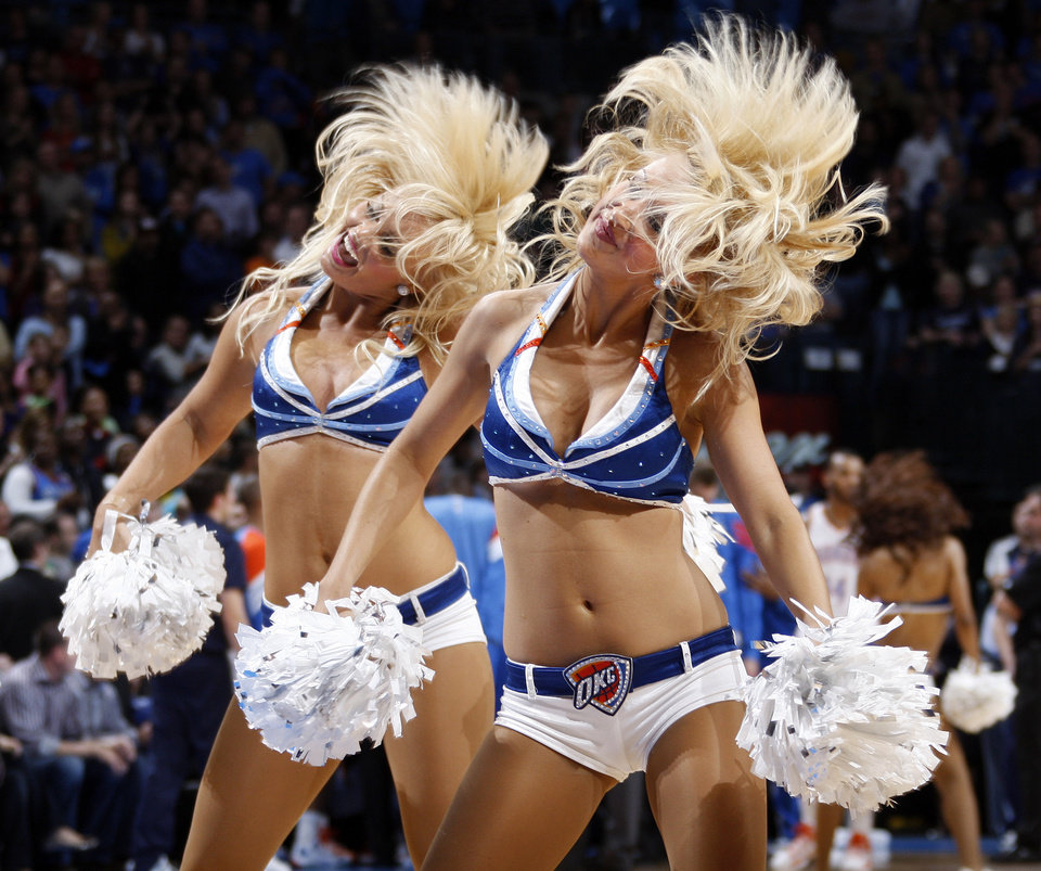 Photo - Members of the Thunder Girls dance team perform during a break in the action at NBA basketball game between the Oklahoma City Thunder and the Dallas Mavericks at Chesapeake Energy Arena in Oklahoma City, Thursday, Dec. 29, 2011. Oklahoma City won, 104-102. Photo by Nate Billings, The Oklahoman