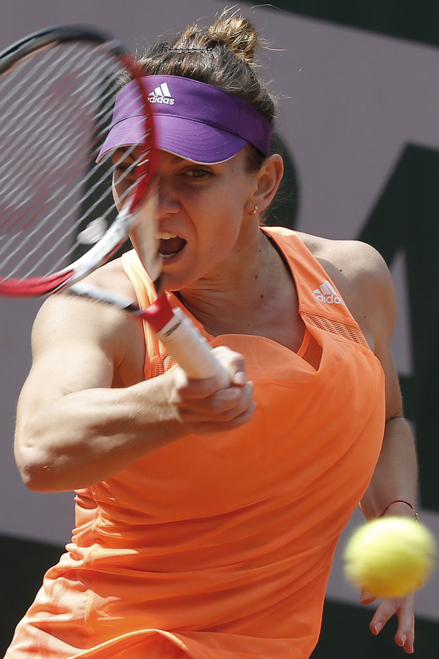 Photo - Romania's Simona Halep returns the ball during the third round match of the French Open tennis tournament against Spain's Maria-Teresa Torro-Flor at the Roland Garros stadium, in Paris, France, Saturday, May 31, 2014. (AP Photo/Michel Euler)
