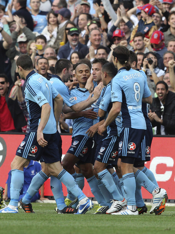 Sydney FC's Alessandro Del Piero, center, celebrates with teammates after scoring a goal against the Newcastle Jets during their A-league soccer match in Sydney, Australia, Saturday, Oct. 13, 2012. (AP Photo/Rob Griffith)