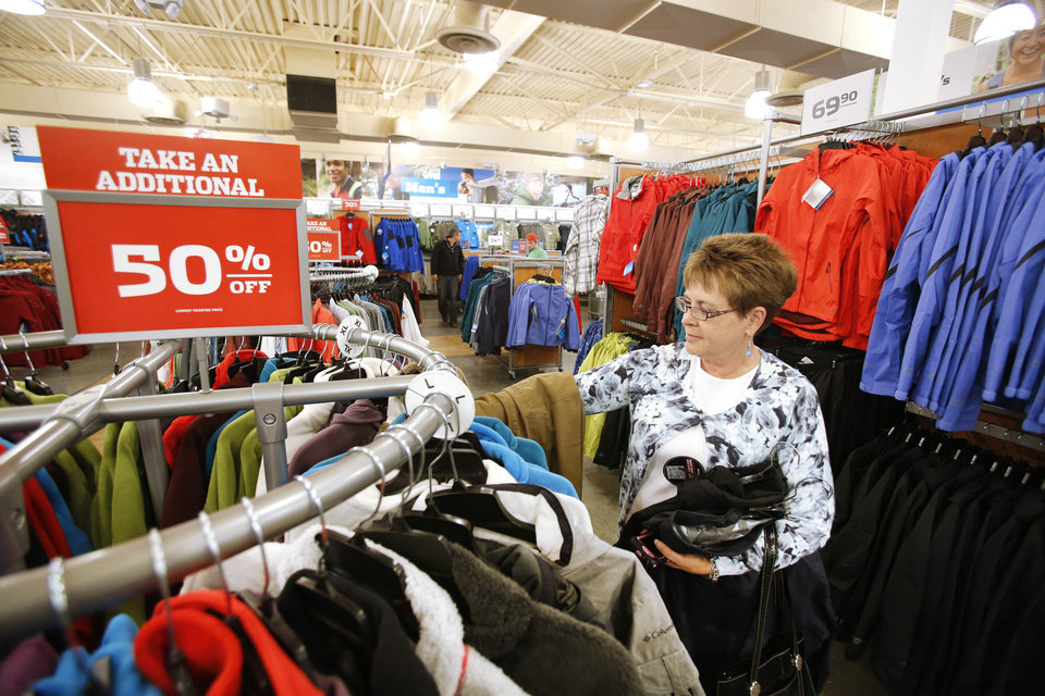 Jo Ann Lowry shops at Columbia Sportswear, one of the new retailers that opened this week at The Outlet Shoppes at Oklahoma City. Photo by Steve Gooch, The Oklahoman
