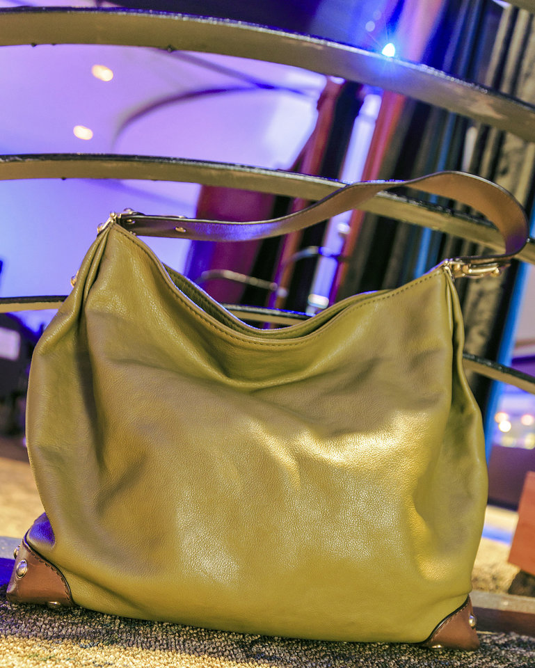 Photo - This Michael Kors handbag is part of the accessory collection at Nearly New, a consignment shop in Oklahoma City. Photo by Chris Landsberger, The Oklahoman.  CHRIS LANDSBERGER