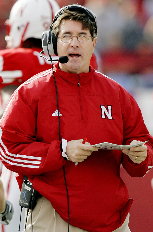 Photo - Nebraska head coach Bill Callahan walks the sidelines during the University of Oklahoma Sooners (OU) at the Nebraska Cornhuskers (NU) college football game at Memorial Stadium in Lincoln, Neb., October 29, 2005. By Nate Billings/The Oklahoman