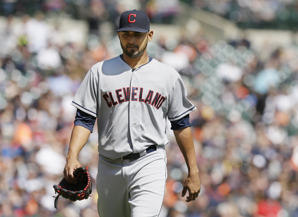 Photo - Cleveland Indians starting pitcher Danny Salazar walks back to the dugout after being relieved during the fifth inning of a baseball game against the Detroit Tigers in Detroit, Thursday, April 17, 2014. (AP Photo/Carlos Osorio)
