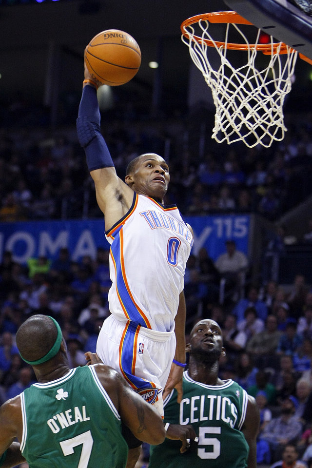 NBA BASKETBALL/OKLAHOMA CITY THUNDER/BOSTON CELTICS  Oklahoma City's Russell Westbrook attempts a dunk  as Boston's Jermaine O'Neal and Kevin Garnett watch during the Thunder - Celtics game Sunday, November 7, 2010 at the Oklahoma City Arena. Photo by Hugh Scott, The Oklahoman ORG XMIT: KOD