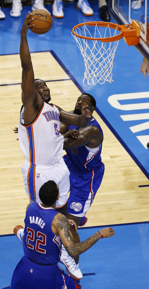 Photo - Kendrick Perkins shoots over DeAndre Jordan (6) and Matt Barnes (22) during Game 2 of the Western Conference semifinals in the NBA playoffs between the Oklahoma City Thunder and the Los Angeles Clippers at Chesapeake Energy Arena in Oklahoma City, Wednesday, May 7, 2014. Photo by Sarah Phipps, The Oklahoman