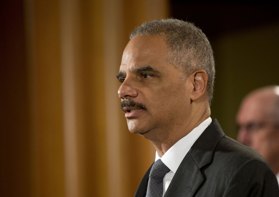 Photo - Attorney General Eric Holder announces at the Justice Department in Washington Monday, July 14, 2014, that Citigroup will pay $7 billion to settle an investigation into risky subprime mortgages, the type that helped fuel the financial crisis. The agreement comes weeks after talks between the sides broke down, prompting the government to warn that it would sue the New York investment bank. The bank had offered to pay less then $4 billion, a sum substantially less that what the Justice Department was asking for. The settlement stems from the sale of securities made up of subprime mortgages, which fueled both the housing boon and bust that triggered the Great Recession at the end of 2007. (AP Photo/Pablo Martinez Monsivais)