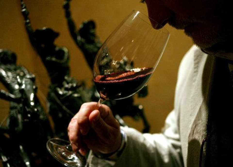 Photo -  Philippe Garmy sniffs a glass of wine at the 2011 Wine Forum of Oklahoma at the Atherton Hotel in Stillwater. Oklahoman Archive Photo   John Clanton -  The Oklahoman