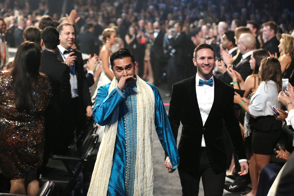 """Photo - Audience members participate in a same sex wedding during a performance of """"Same Love"""" by Macklemore and Ryan Lewis at the 56th annual Grammy Awards at Staples Center on Sunday, Jan. 26, 2014, in Los Angeles. (Photo by Matt Sayles/Invision/AP)"""