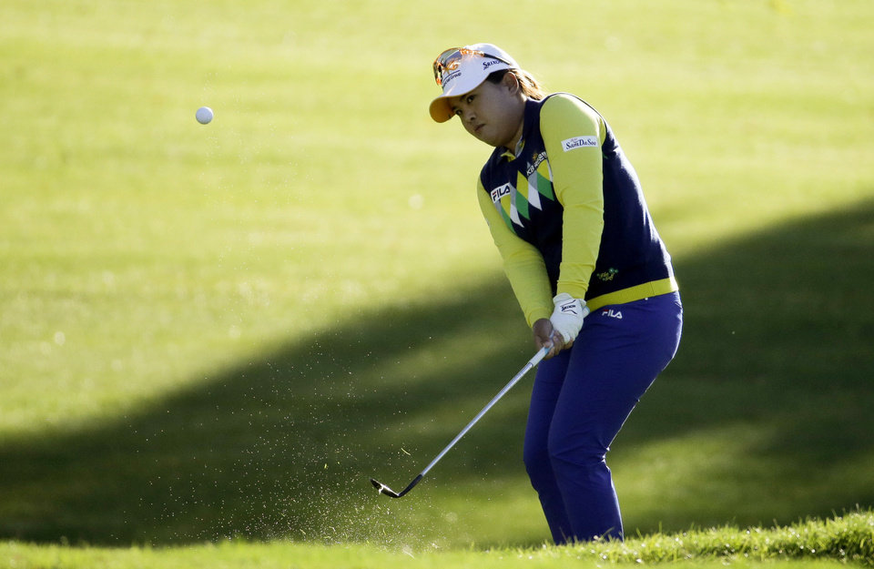 Photo - Inbee Park, of South Korea, chips to the green on the 11th hole during the first round at the LPGA Kraft Nabisco Championship golf tournament Thursday, April 3, 2014 in Rancho Mirage, Calif. (AP Photo/Chris Carlson)