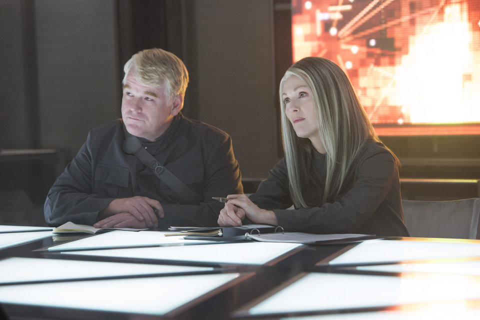 Photo - This photo released by Lionsgate shows, Philip Seymour Hoffman, left, as Plutarch Heavensbee and Julianne Moore as President Coin in a scene from the film,