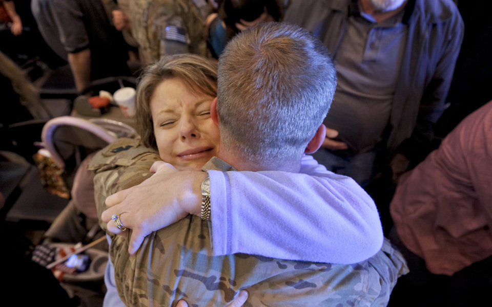 Kristy Brock is overcome with emotion as she hugs her son, Jake Farrow, during the return ceremony for more than 200 National Guard 45th Infantry Brigade Combat Team troops at the National Guard Base on Monday, March 12, 2012, in Oklahoma City, Oklahoma. Photo by Chris Landsberger, The Oklahoman