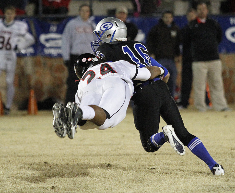 Photo - Guthrie's Bryan Dutton (16) is taken down by East Central's Damian Gibson (24) during a high school football game between Guthrie and East Central at The Rock in Guthrie, Friday, Nov. 18, 2011.  Photo by Garett Fisbeck, The Oklahoman